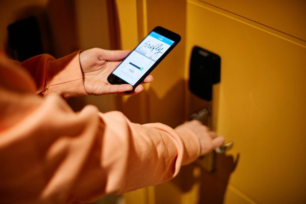 Hotel key on phone being used to open bedroom door